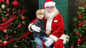 My 3 year old son Sam posing with Santa at the Zoo.